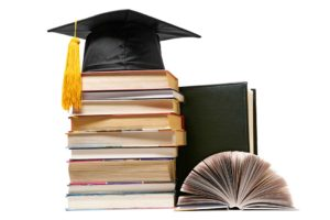 Books and graduation cap
